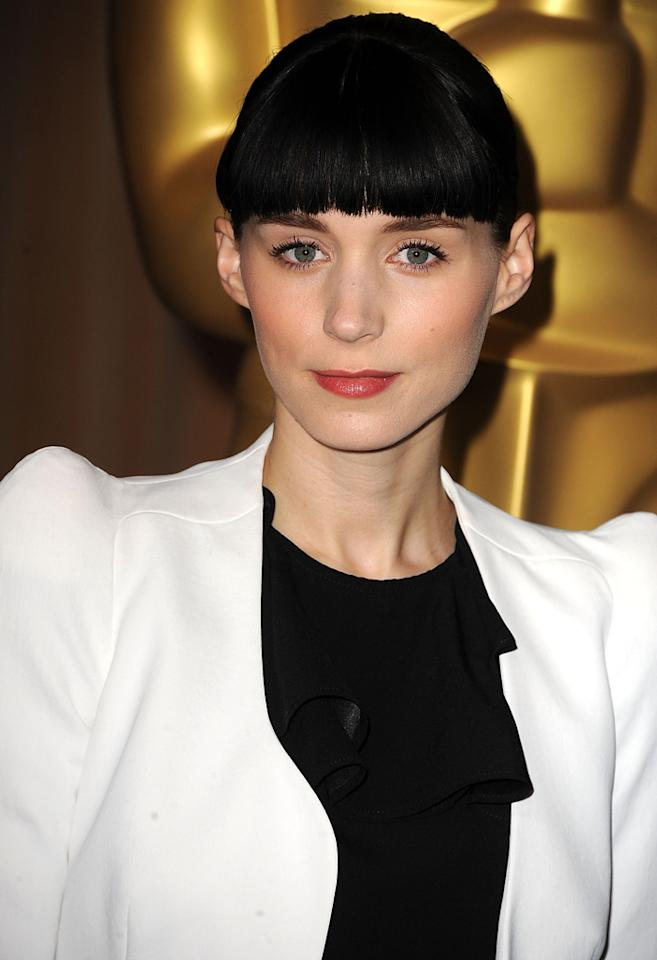 "Celebrity name: Rooney Mara Birth name: Patricia ""Tricia"" Rooney Mara The star of ""The Girl With the Dragon Tattoo"" is a girl with a different name. Mara, who has been nominated for an Oscar in the best actress category for her memorable performance, started out life as Patricia, but goes by her two family names: Rooney Mara.  The 26-year-old's last name was known before she became famous: Her grandfather, Wellington Mara and her uncle, John Mara, were longtime owners of the New York Giants."
