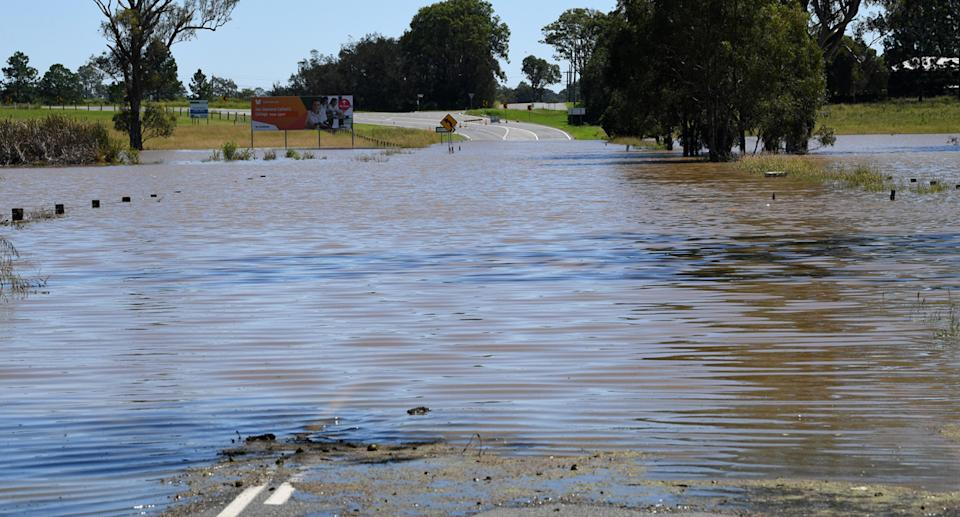 Flood waters from the Logan River are seen cutting across the Waterford Tamborine Road at Waterford in Logan City, Thursday, March 25, 2021.