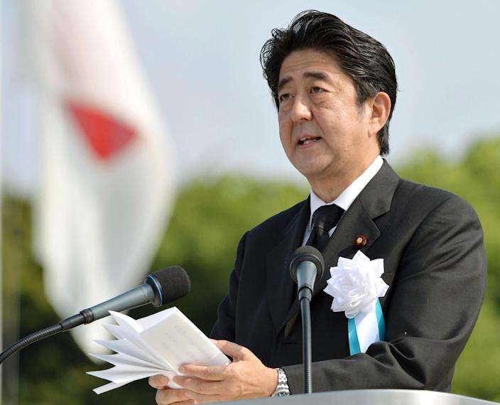 Japan's Prime Minister Shinzo Abe delivers his speech at the Hiroshima Peace Memorial Park during the ceremony to mark the 68th anniversary of the atomic bombing of Hiroshima, western Japan, Tuesday, Aug. 6, 2013. (AP Photo/Kyodo News) JAPAN OUT, MANDATORY CREDIT
