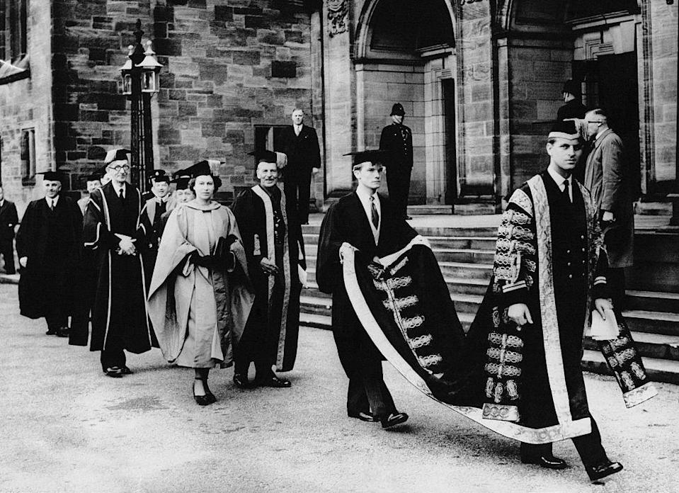 <p>Prince Philip, who was appointed Chancellor of the University of Wales, presents an honorary doctorate in music to his wife, Princess Elizabeth. </p>