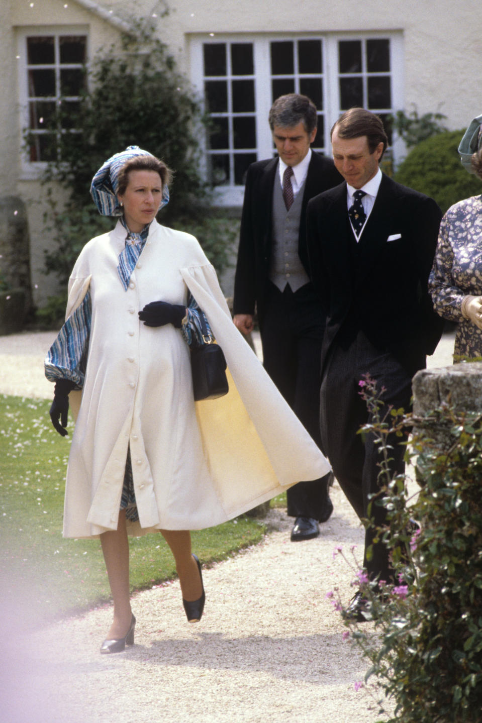 When she was expecting Zara, she wore this fantastic cape coat to the wedding of Captain Phillips' sister Sarah in 1981. In classic Anne style, she rewore the coat on other occasions. (Getty Images)