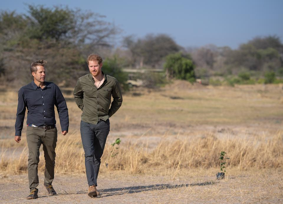 Prince Harry looked dapper as he styled his forest green shirt with a pair of navy chinos and tan desert boots in Botswana. [Photo: Getty Images]