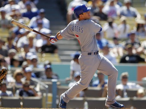 Chicago Cubs' Josh Vitters flies out as he pinch hits in his first major league at bat during his debut against the Los Angeles Dodgers during the seventh inning of a baseball game on Sunday, Aug. 5, 2012, in Los Angeles. (AP Photo/Danny Moloshok)