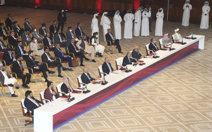 Abdullah Abdullah, center, chairman of Afghanistan's High Council for National Reconciliation, talks at the opening session of the peace talks between the Afghan government and the Taliban in Doha, Qatar, Saturday, Sept. 12, 2020. (AP Photo/Hussein Sayed)