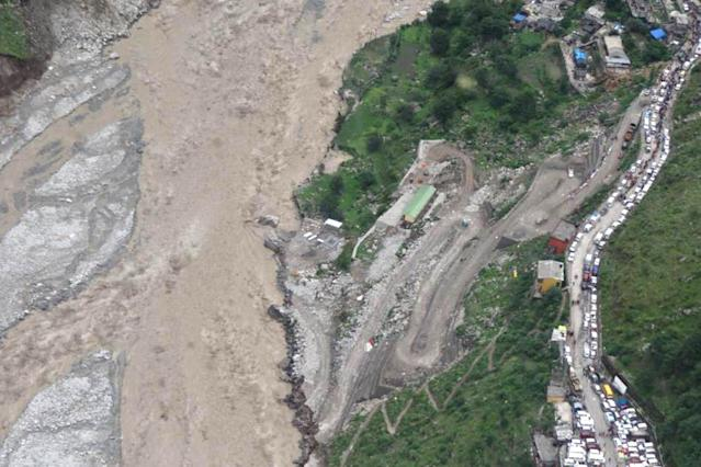 "In this handout photograph released by The Ministry of Defence on June 18, 2013, shows an aerial view of flood damage in the northern Indian state of Uttarakhand on June 18, 2013. Torrential rains and flash floods washed away homes and roads in north India, leaving at least feared 60 people dead and thousands stranded, as the annual monsoon hit the country earlier than normal, officials said. Authorities called in military helicopters to try to rescue residents and pilgrims cut off by rising rivers and landslides triggered by more than three days of rain in the Himalayan state of Uttarakhand, officials said. -----EDITORS NOTE---- RESTRICTED TO EDITORIAL USE - MANDATORY CREDIT ""AFP PHOTO / MINISTRY OF DEFENCE"" - NO MARKETING NO ADVERTISING CAMPAIGNS - DISTRIBUTED AS A SERVICE TO CLIENTS"