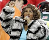 <p>Aretha Franklin wears a grey and black striped fur coat while performing the national anthem before the Super Bowl XL football game between the Pittsburgh Steelers and Seattle Seahawks in Detroit, Mich. (AP Photo/Michael Conro </p>