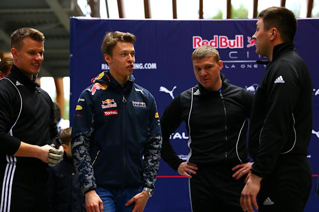 SOCHI, RUSSIA - APRIL 27: Daniil Kvyat of Russia and Red Bull Racing speaks with members of the Russian national bobsleigh team during previews to the Formula One Grand Prix of Russia at Sanki Sliding Centre on April 27, 2016 in Sochi, Russia. (Photo by Dan Istitene/Getty Images)