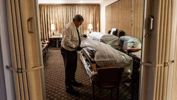 PHOTO: Funeral Director Joe Neufeld inventories the bodies of coronavirus victims bound for burial, in the main chapel of the Gerard J. Neufeld Funeral Home in Queens, New York, April 26, 2020. (Timothy Fadek/Redux)