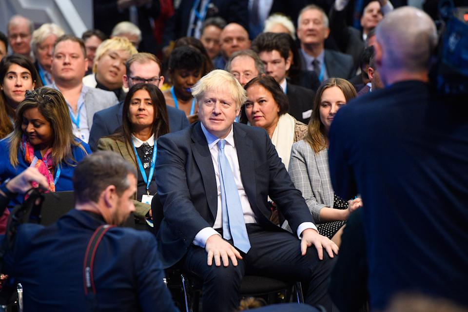 Prime Minister Boris Johnson in the audience as Chancellor of the Exchequer Rishi Sunak addresses the Conservative Party Conference in Manchester. Picture date: Monday October 4, 2021. Photo credit should read: Matt Crossick/Empics