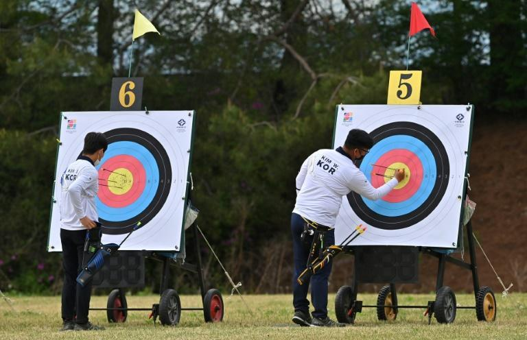 Archers Kim Woo-jin (right) and Kim Je-deok check their scores during the final round of the South Korea national archery trials for the Tokyo 2020 Olympics in Wonju