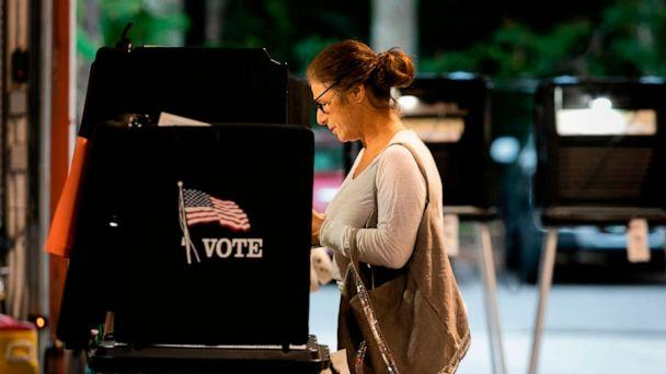 PHOTO: A woman casts her vote during the Florida primary election at Doris & Phil Sanford Fire Rescue Station Coral Gables in Miami, on March 17, 2020. (Eva Marie Uzcategui/AFP via Getty Images)