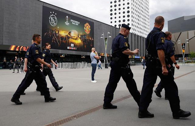 <p>Police officers outside the stadium ahead of the Europa League final in Stockholm, Sweden on May 23, 2017. (Phil Noble Livepic/Reuters) </p>