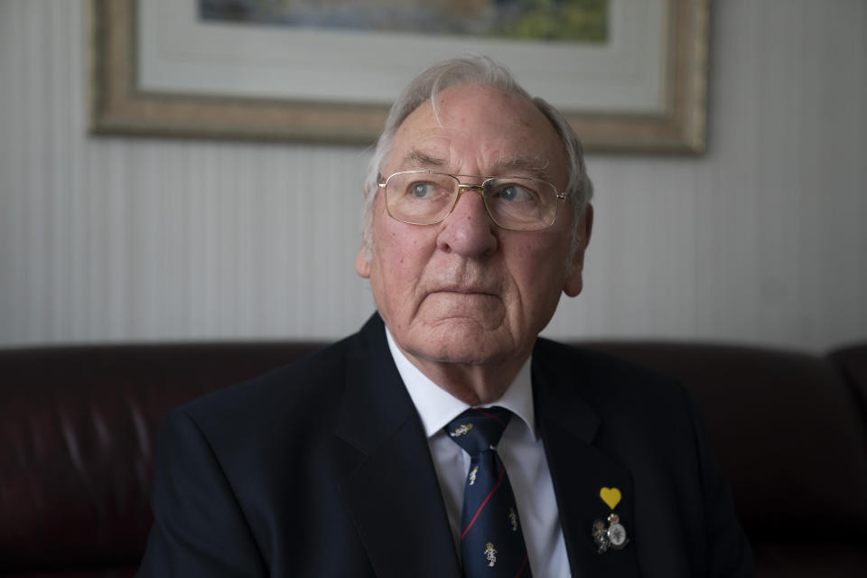 "Major Gordon Bonner poses for a photo at his home in Leeds, England, Saturday Jan. 23, 2021. For nine months, Bonner has been in the ""hinterlands of despair and desolation"" after losing Muriel his wife of 63 years to the coronavirus pandemic that has now taken the lives of more than 100,000 people in the United Kingdom. ( AP Photo/Jon Super)"