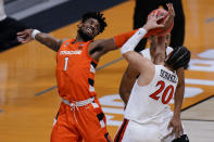 Syracuse forward Quincy Guerrier (1) fights for a rebound with San Diego State guard Jordan Schakel (20) during the first half of a college basketball game in the first round of the NCAA tournament at Hinkle Fieldhouse in Indianapolis, Friday, March 19, 2021. (AP Photo/AJ Mast)