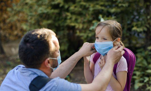 """In high-conflict divorces -- or if parents have fiercely argued about safety precautions throughout the pandemic -- experts caution against attempting to """"convince"""" an ex to vaccinate a child.  (Photo: StockPlanets via Getty Images)"""