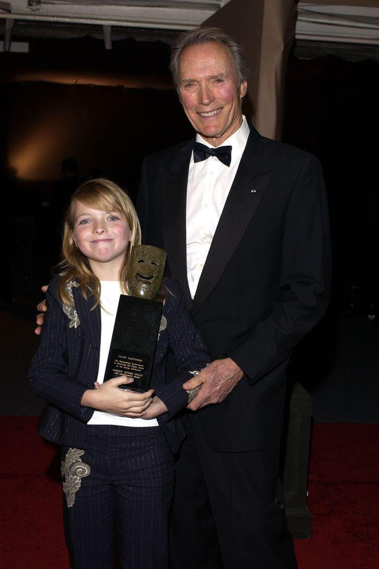 <p>In 2003, the American Film Institute honored Eastwood with a Lifetime Achievement Award. The actor and director is seen here with his daughter, Francesca, who holds his award from the evening. </p>