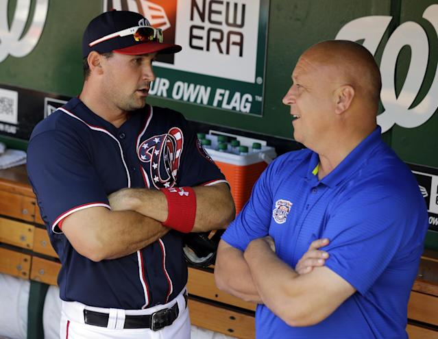 Washington Nationals third baseman Ryan Zimmerman, left, and former Baltimore Orioles third baseman Cal Ripkin Jr. talk in the dugout before the Nationals' baseball game against the San Francisco Giants at Nationals Park Thursday, Aug. 15, 2013, in Washington. (AP Photo/Alex Brandon)
