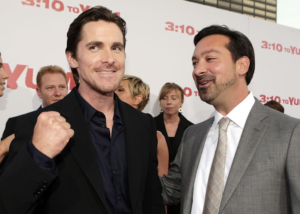 """LOS ANGELES - AUGUST 21:  Actor Christian Bale (L) and director James Mangold pose at the premiere of Lionsgate's """"3:10 to Yuma"""" at the Mann National Theater on August 21, 2007 in Los Angeles, California. (Photo by Kevin Winter/Getty Images)"""