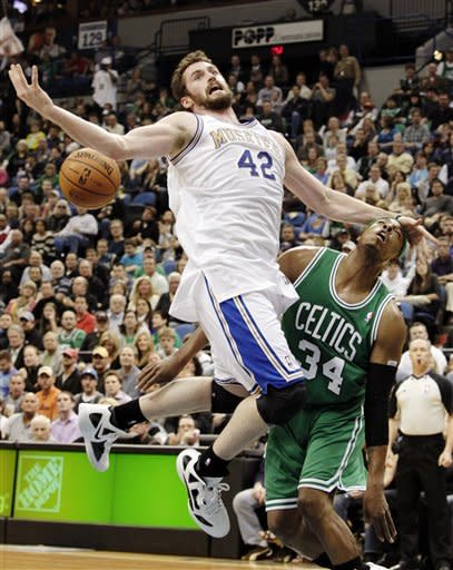 Minnesota Timberwolves forward Kevin Love (42), left, is fouled by Boston Celtics forward Paul Pierce (34) while driving to the basket during the first quarter of an NBA basketball game on Friday, March 30, 2012, in Minneapolis. (AP Photo/Genevieve Ross)