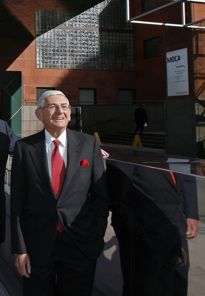FILE - In this Dec. 23, 2008 file photo, billionaire Eli Broad poses for a picture outside the MOCA museum downtown Los Angeles. Eli Broad, the billionaire philanthropist, contemporary art collector and entrepreneur who co-founded homebuilding pioneer Kaufman and Broad Inc. and launched financial services giant SunAmerica Inc., died Friday, April 30, 2021 in Los Angeles. He was 87. (AP Photo/Damian Dovarganes, File)