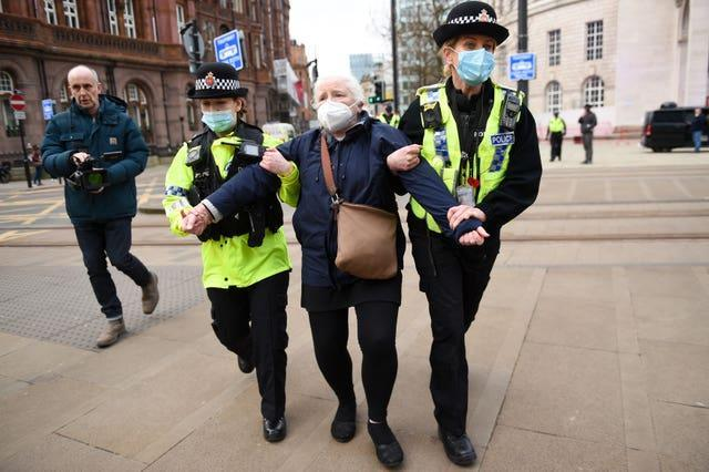 Police detain an NHS worker after breaking up a protest in Manchester over the proposed 1% pay rise for NHS workers from the Government