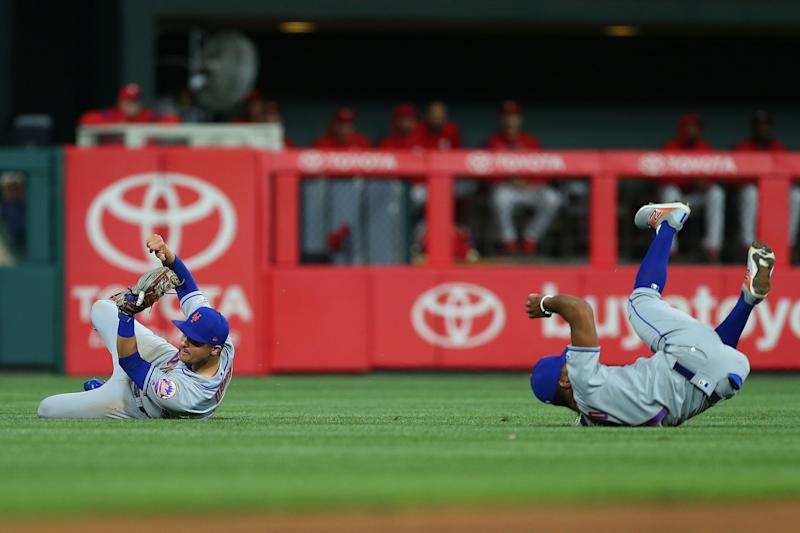 PHILADELPHIA, PA - APRIL 16: Third baseman J.D. Davis #28 of the New York Mets makes a catch after almost colliding with shortstop Amed Rosario #1 on a ball off the bat of Bryce Harper of the Philadelphia Phillies in the fourth inning at Citizens Bank Park on April 16, 2019 in Philadelphia, Pennsylvania. (Photo by Rich Schultz/Getty Images)