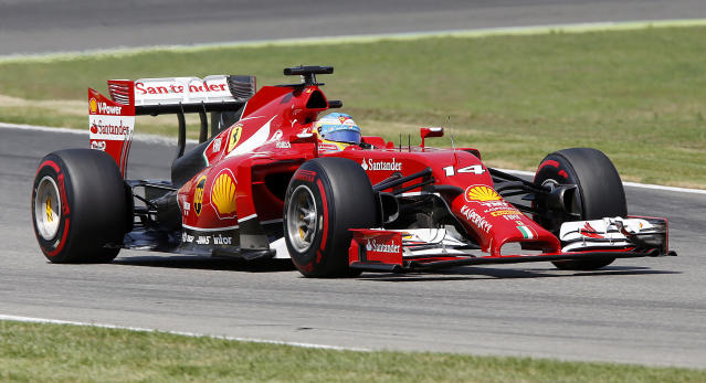 Ferrari driver Fernando Alonso of Spain races during the qualifying of the German Formula One Grand Prix in Hockenheim, Germany, Saturday, July 19, 2014. The German Grand Prix will be held on Sunday.(AP Photo/Michael Probst)