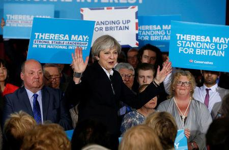 Britain's Prime Minister Theresa May delivers a speech to Conservative Party members in Mawdesley village hall, Ormskirk