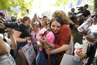 """Britney Spears supporters celebrate outside the Stanley Mosk Courthouse, Wednesday, Sept. 29, 2021, in Los Angeles. A judge on Wednesday suspended Britney Spears' father from the conservatorship that has controlled the singer's life and money for 13 years, saying the arrangement """"reflects a toxic environment."""" (AP Photo/Chris Pizzello)"""