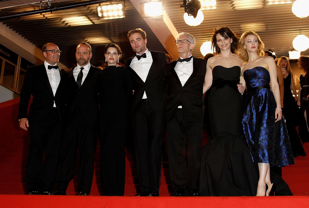 "CANNES, FRANCE - MAY 25:  (L-R) Producer Martin Katz, actors Paul Giamatti, Emily Hampshire, Robert Pattinson, director David Cronenberg, actors Juliet Binoche and Sarah Gadon depart the ""Cosmopolis"" premiere during the 65th Annual Cannes Film Festival at Palais des Festivals on May 25, 2012 in Cannes, France.  (Photo by Andreas Rentz/Getty Images)"