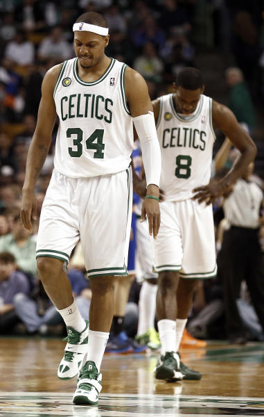 Boston Celtics' Paul Pierce (34) and Jeff Green head back up court during the fourth quarter of their 90-76 loss to the New York Knicks in Game 3 of a first round NBA basketball playoff series in Boston, Friday, April 26, 2013. (AP Photo/Winslow Townson)