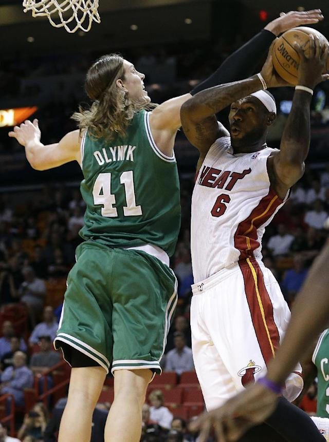 Miami Heat's LeBron James (6) shoots as Boston Celtics' Kelly Olynyk (41) defends during the first half of an NBA basketball game Saturday, Nov. 9, 2013, in Miami. (AP Photo/Lynne Sladky)