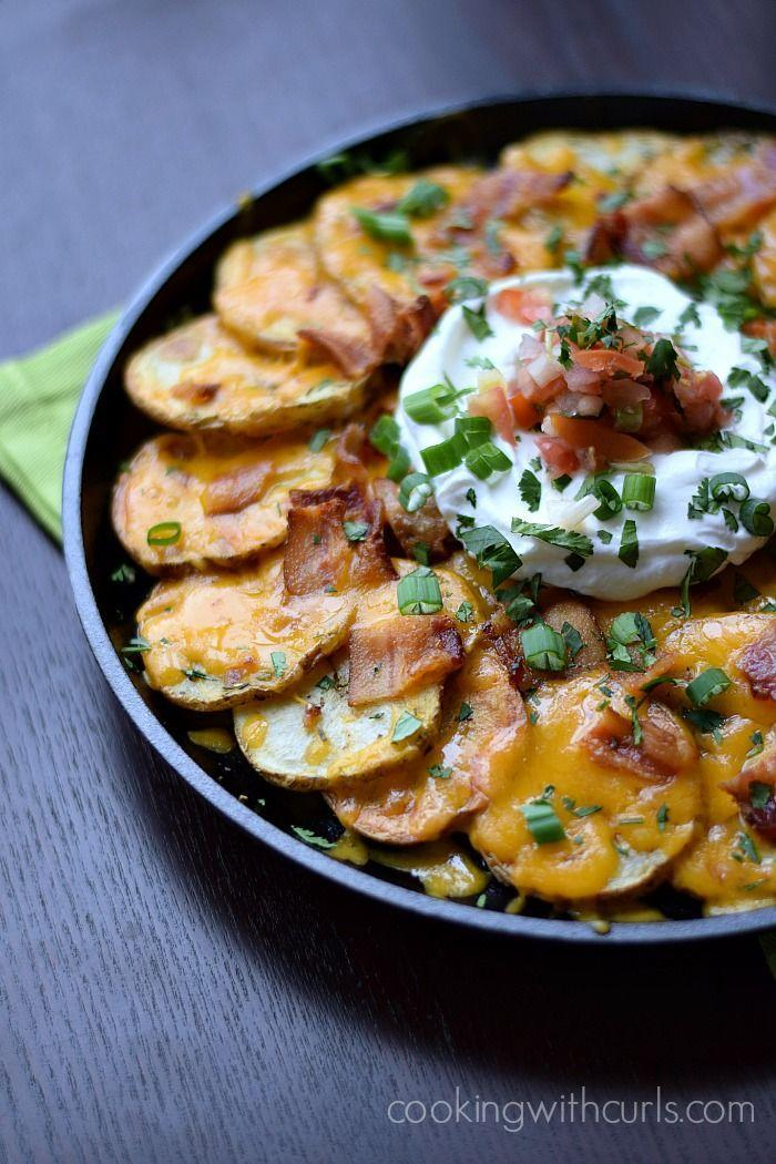 """<p>Actual potatoes instead of potato chips? Don't mind if we do! </p><p><a href=""""http://cookingwithcurls.com/2014/03/05/irish-nachos/"""" rel=""""nofollow noopener"""" target=""""_blank"""" data-ylk=""""slk:Get the recipe from Cooking with Curls »"""" class=""""link rapid-noclick-resp""""><em>Get the recipe from Cooking with Curls »</em></a><br></p>"""