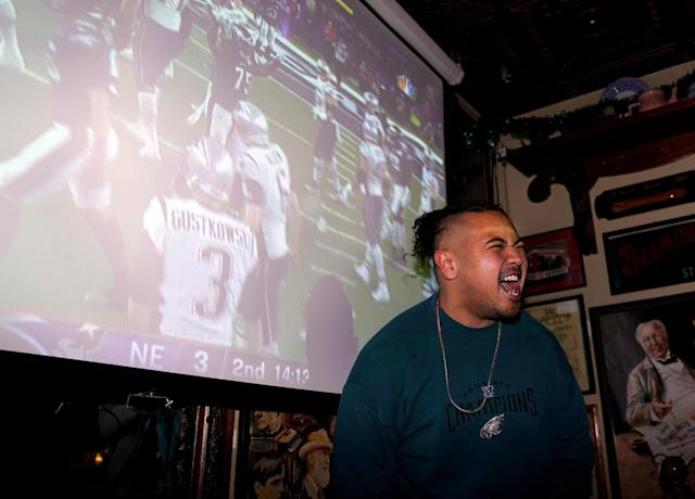 Football fan Nero Borja reacts as he watches Super Bowl LII between the New England Patriots and the Philadelphia Eagles at the city's oldest tavern, McGillin's Olde Ale House in Philadelphia, Pennsylvania, February 4, 2018. REUTERS/Jessica Kourkounis