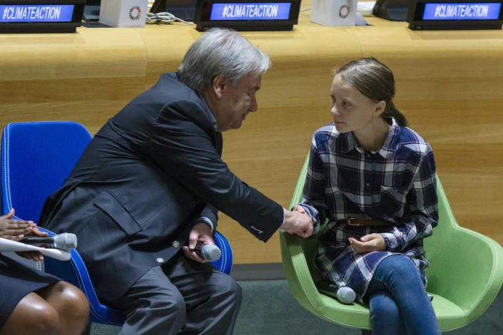 FILE - In this Saturday, Sept. 21, 2019 file photo Swedish environmental activist Greta Thunberg, right, shakes hands with U.N. Secretary-General Antonio Guterres, during the Youth Climate Summit at United Nations headquarters. In his General Assembly opening address on Tuesday, Sept. 21, 2021, U.N. Secretary-General Antonio Guterres practically scolded world leaders for disappointing young people with a perceived inaction on climate change, inequalities and the lack of educational opportunities, among other issues important to young people.(AP Photo/Eduardo Munoz Alvarez, file)