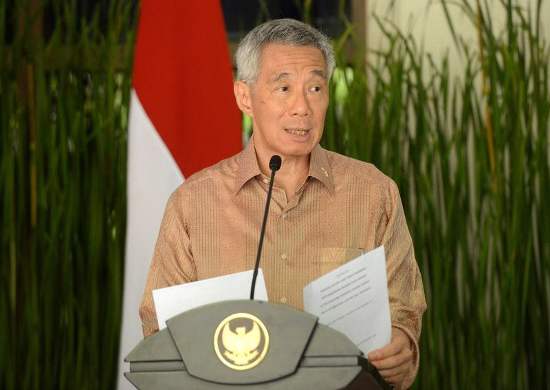 Singapore's Prime Minister Lee Hsien Loong speaks to journalist after bilateral meeting on the International Monitary Fund and World Bank annual meetings in Nusa Dua