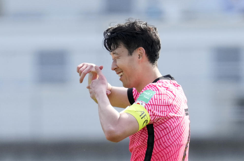 South Korea's Son Heung-min celebrates after scoring his side's second goal on a penalty kick against Lebanon during their Asian zone Group H qualifying soccer match for the FIFA World Cup Qatar 2022 at Goyang stadium in Goyang, South Korea, Sunday, June 13, 2021. (AP Photo/Lee Jin-man)