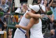 Australia's Ashleigh Barty, right, hugs Czech Republic's Karolina Pliskova after defeating her in the women's singles final on day twelve of the Wimbledon Tennis Championships in London, Saturday, July 10, 2021. (AP Photo/Kirsty Wigglesworth)