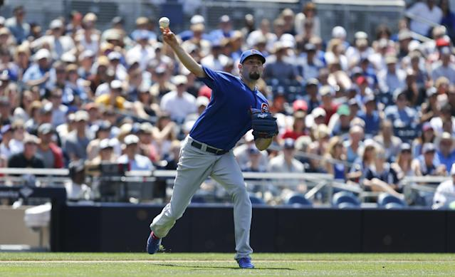 Chicago Cubs starting pitcher Jason Hammel fires a throw to first after fielding a bunt by San Diego Padres' Cameron Maybin during the fifth inning of a baseball game Sunday, May 25, 2014, in San Diego. (AP Photo/Lenny Ignelzi)