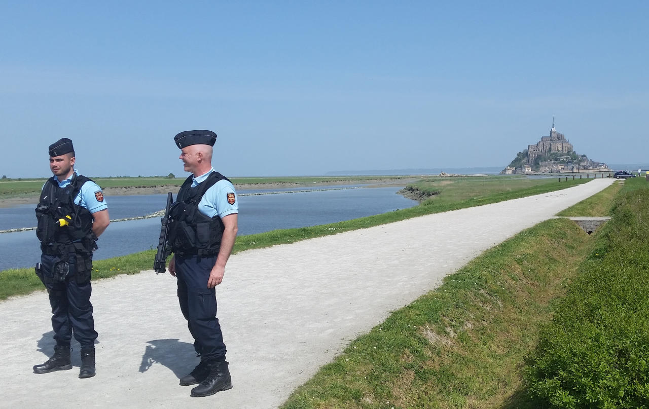 Police attend the scene of an evacuation at Mont Saint-Michel, on France's northern coast, Sunday April 22, 2018. Authorities are evacuating tourists and others from the Mont-Saint-Michel abbey and monument in western France after a visitor apparently threatened to attack security services. (AP Photo/Randall Hackley)