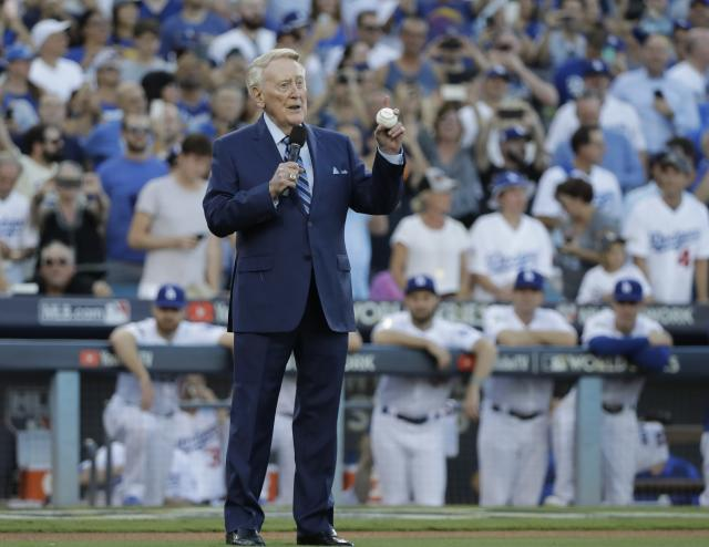 Vin Scully won't return to the broadcast booth for the NLCS. (AP Photo)