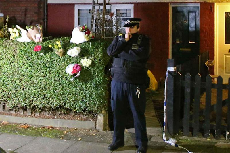 A police officer stands at the scene of the killing in Muswell Hill