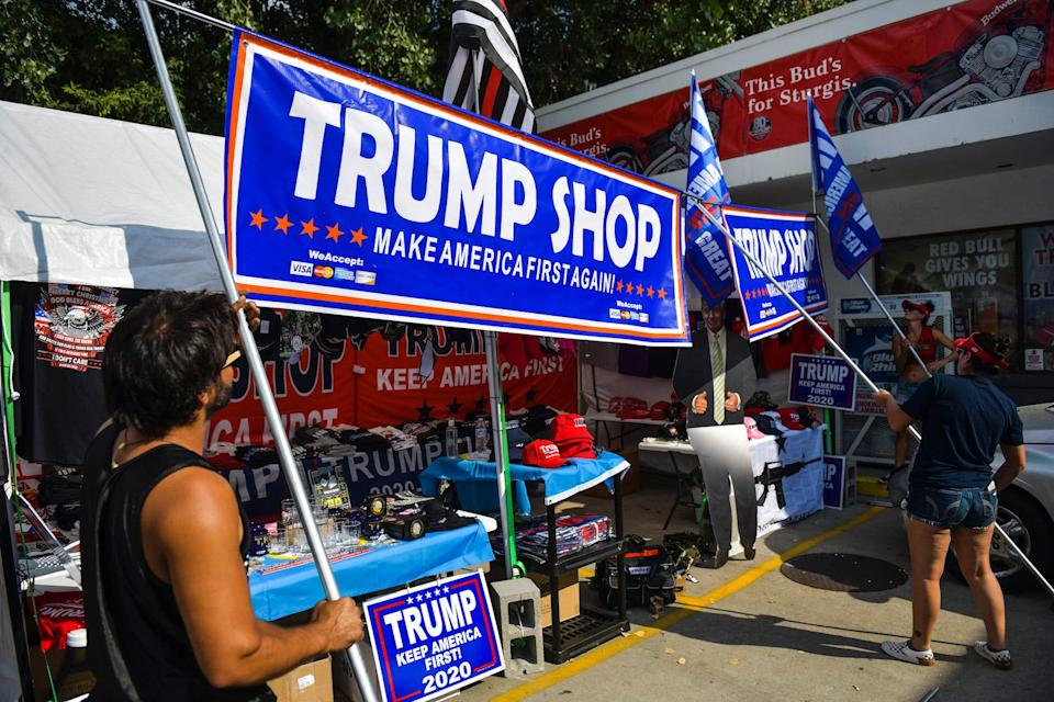 Vendors set up their Trump Shop stand a day before the start of the Sturgis Motorcycle Rally on August 6.