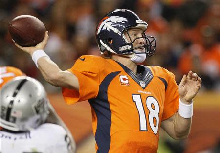 Denver Broncos quarterback Peyton Manning winds up to throw against the Oakland Raiders during the third quarter of their NFL football game in Denver September 23, 2013. REUTERS/Rick Wilking