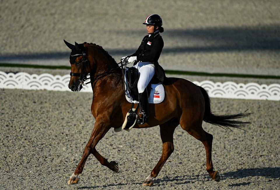 Singapore's Caroline Chew in action with her horse Tribiani in the dressage qualifers at Tokyo Olympics.