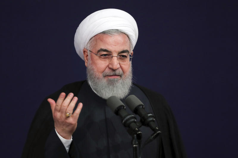 In this photo released by official website of the office of the Iranian Presidency, President Hassan Rouhani speaks at a ceremony to mark the start of the Iranian academic year at Tehran University, Iran, Sunday, Oct. 14, 2018. Rouhani on Sunday tried to downplay U.S. sanctions targeting the country's vital oil and gas sector that are set to be restored next month. (Iranian Presidency Office via AP)
