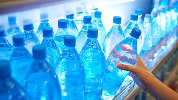 PHOTO: Someone takes a bottle of water from a shelf in an undated stock photo. (STOCK PHOTO/Getty Images)