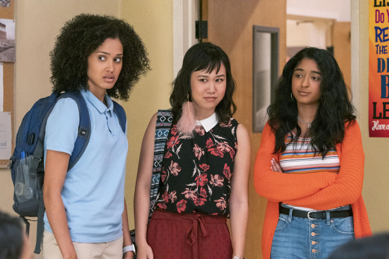 """This handout photo provided by Netflix shows Lee Rodriguez as Fabiola Torres, from left, Ramona Young as Eleanor Wong and Maitreyi Ramakrishnan as Devi Vishwakumar in a scene from """"Never Have I Ever."""" (Lara Solanki/Netflix via AP)"""