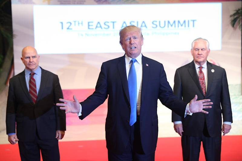 Flanked by U.S. National Security Advisor H.R. McMaster, left, and U.S. Secretary of State Rex Tillerson, right, U.S. President Donald Trump offers a departing statement after participating in an East Asia Summit, Tuesday, Nov. 14, 2017, in Manila, Philippines. Trump is on a five country trip through Asia traveling to Japan, South Korea, China, Vietnam and the Philippines. (AP Photo/Andrew Harnik)