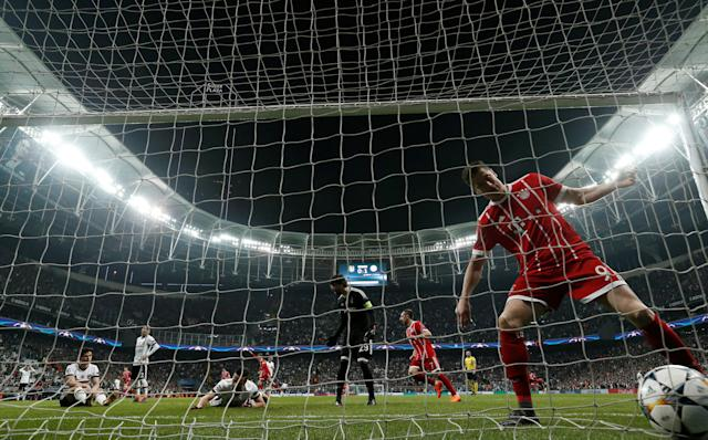 Soccer Football - Champions League Round of 16 Second Leg - Besiktas vs Bayern Munich - Vodafone Arena, Istanbul, Turkey - March 14, 2018 Bayern Munich's Robert Lewandowski picks the ball out of the net after Besiktas' Gokhan Gonul scores an own goal and the second goal for Bayern Munich REUTERS/Murad Sezer